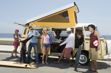 southern california: Group of young people by camper van