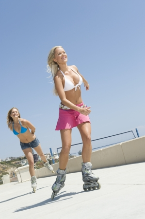 blading: Young women on rollerblades LANG_EVOIMAGES