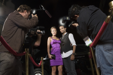 media event: Celebrity couple being photographed at media event LANG_EVOIMAGES