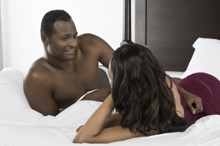 mid adult couple: Mid adult couple lying on bed