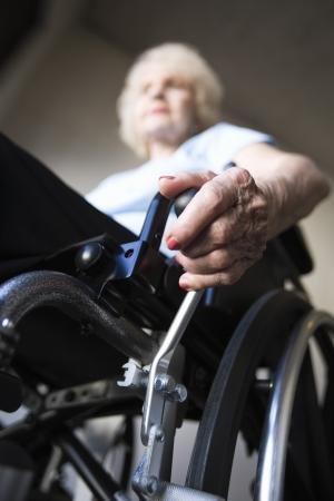 Woman operating wheelchair