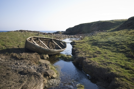 Abandoned boat by stream in peat Stock Photo - 20717151