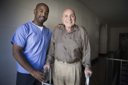 challenged: Healthcare worker with elderly man LANG_EVOIMAGES
