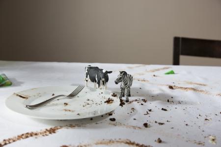 animal figurines: Animal figurines on messy table LANG_EVOIMAGES