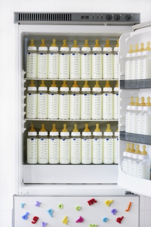 baby bottle: Fridge full of baby bottles with milk