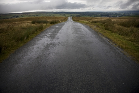 Wet road in Yorkshire Dales Yorkshire England Stock Photo - 20717503