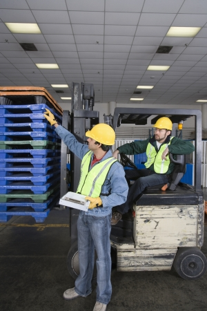 Men working in factory Stock Photo - 20717684