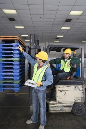 Men working in factory Stock Photo - 20717684