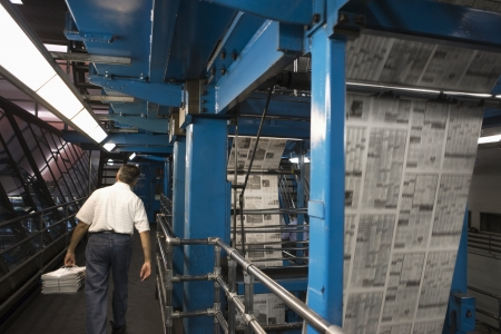 Man working in newspaper factory Stock Photo - 20717711