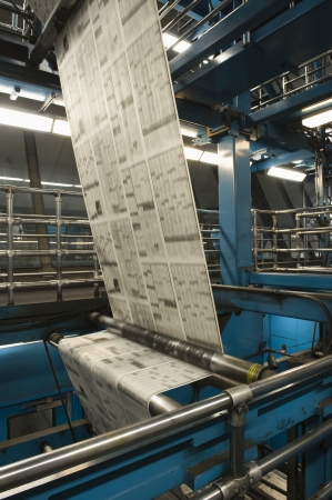 printing press: Newspaper production and printing process