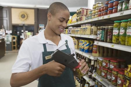 Teenage supermarket employee Stock Photo