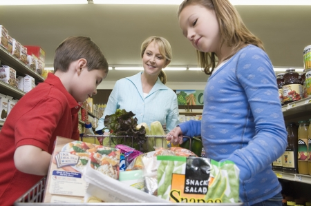 single mother: Single mother shopping with son and daughter