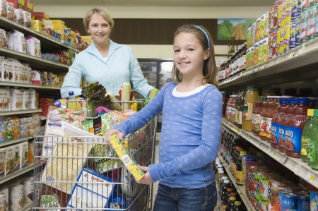single mother: Single mother shopping with daughter