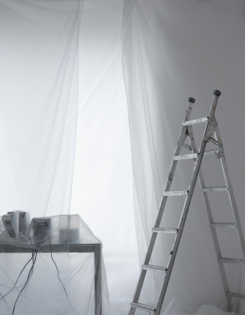 step ladder: Desk with phones and cables covered in transparent dust sheets with step ladder LANG_EVOIMAGES