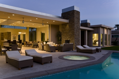 jacuzzi: House exterior with sunloungers on patio by swimming pool LANG_EVOIMAGES