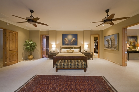ceiling fan: Bedroom interior with ceiling fans