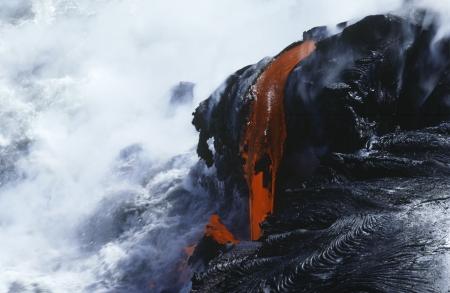 USA Hawaii Big Island Volcanos National Park cooling lava and surf