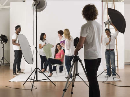 photo studio: Group of young people in studio during preparing photo session