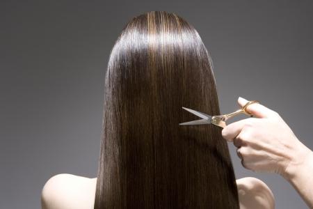 end of a long day: Woman having haircut rear view