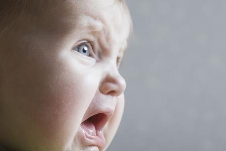baby facial expressions: Baby girl crying close-up