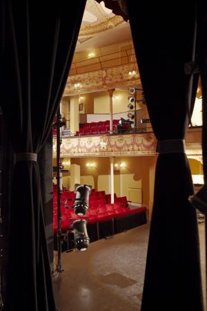 view through: Theatre view through stage curtain