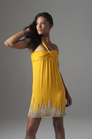 Woman stands in bright yellow dress Stock Photo