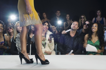 fashion model catwalk: Low section of womans walking in black high heeled shoes on fashion catwalk