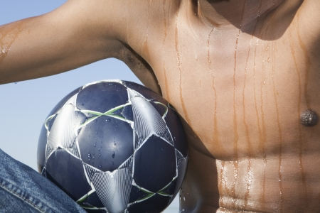 unknown age: Mans torso with soccer ball LANG_EVOIMAGES