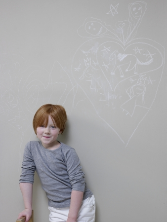 rolled up sleeves: 7-8 Year old girl stands below chalk drawing on wall