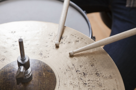 cymbal: Drumsticks on metal cymbal