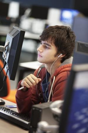 using computer: University student using computer