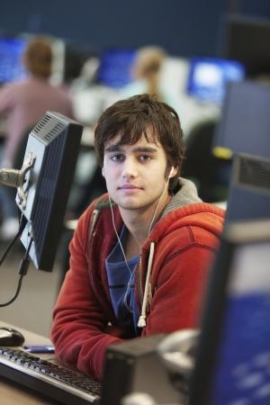 technology: University student using computer