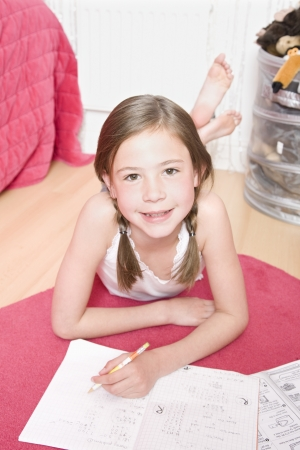 tweens: Young girl doing homework