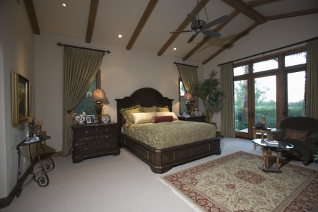 riverside county: Palm Springs bedroom with beamed ceiling and patio doors
