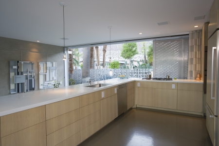 Open plan kitchen furnished in light wood Palm Springs Stock Photo - 20739992