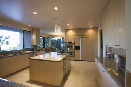 Open plan kitchen in neutral colours Palm Springs Stock Photo - 20739997
