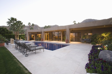 showhome: Poolside area with sun loungers Palm Springs home