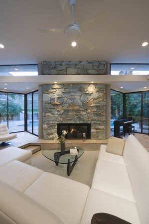 glass topped: Sunken seating area and exposed stone fireplace of Palm Springs home