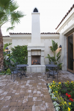 showhome: Lit stove in courtyard garden of Palm Springs home