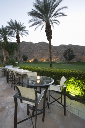 patio chairs: Patio chairs and tables in Palm Springs