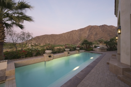 showhome: Paved poolside area of Palm Springs home