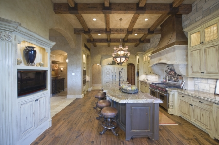 at home: Wood beamed ceiling of Palm Springs kitchen
