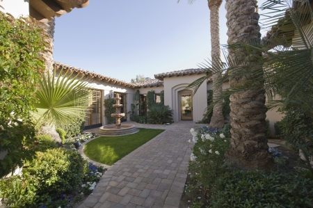 showhome: Paved path and water fountain in Palm Springs garden exterior