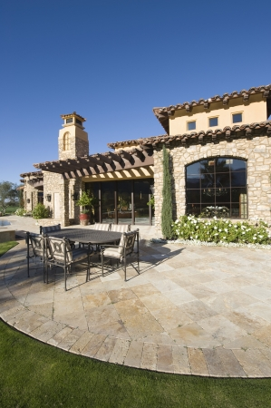 showhome: Paved dining area of Palm Springs hacienda