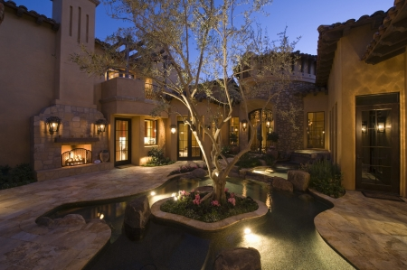 showhome: Lit Palm Springs courtyard with pool