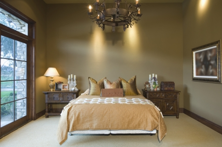 riverside county: Chandelier hangs over bed in Palm Springs home