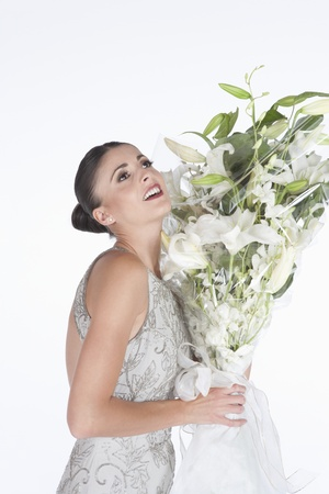 accepts: Woman accepts a bouquet of white flowers