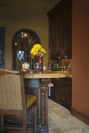 riverside county: Bar stool in kitchen of Palm Springs home LANG_EVOIMAGES