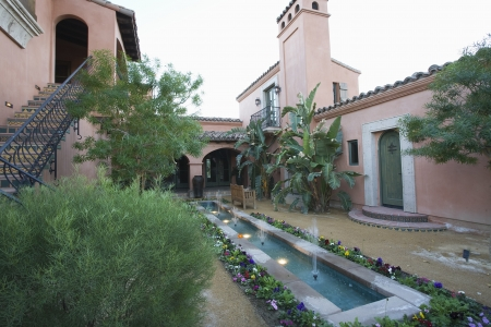 riverside county: Water feature and metal steps of Palm Springs courtyard garden LANG_EVOIMAGES