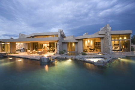 Palm Springs swimming pool and house exterior at dusk Stock Photo